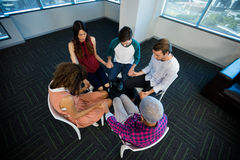 Creative business team holding each others hand at office Stock Photos