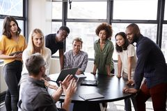 Free Creative Business Team Listening To Colleague At A Brainstorm Meeting Stock Photos - 153628883