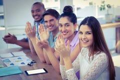 Creative business team at meeting applauding Royalty Free Stock Photos