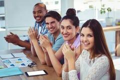 Creative business team at meeting applauding Stock Photo