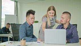 People Group Using Laptop in Modern Startup Office. Creative business team meeting in modern start up office female team leader pointing at screen discussing Royalty Free Stock Images