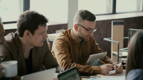 Creative business team in modern trendy office. Small start-up company use the digital tablet and laptop. stock footage