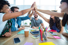 Creative business team putting hands together. At the office Royalty Free Stock Photo