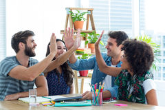 Creative business team putting their hands together. In meeting at office stock images