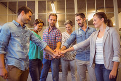 Creative business team putting their hands together. Creative business team putting hands together at the office Royalty Free Stock Photo