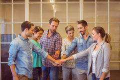 Creative business team putting their hands together. At office Royalty Free Stock Photos