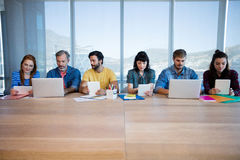 Creative business team sitting in a row and working together Royalty Free Stock Photo