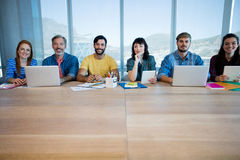 Creative business team sitting in a row and working together in office Royalty Free Stock Photo