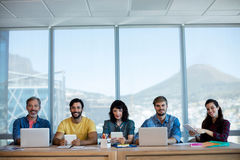 Creative business team sitting in a row and working together on table Royalty Free Stock Photos