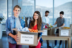 Creative business team sorting clothes in donation box Royalty Free Stock Photography