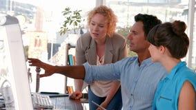 Creative business team using computer stock video