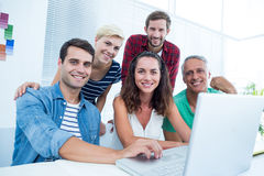 Creative business team using laptop in meeting Stock Image