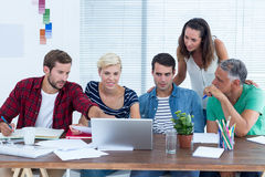 Creative business team using laptop in meeting Stock Images