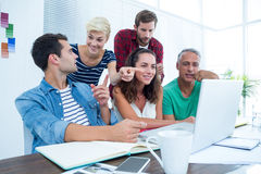 Creative business team using laptop in meeting Stock Photos
