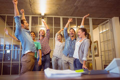 Creative business team waving their hands Stock Images