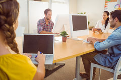 Creative business team working on electronic device Stock Photo