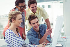 Creative business team working hard together on pc Royalty Free Stock Image