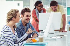 Creative business team working hard together on pc Stock Image