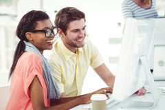 Creative business team working hard together on pc Stock Images