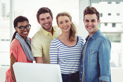 Creative business team working hard together on pc Royalty Free Stock Photo