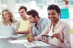 Creative business team working on a laptop together Royalty Free Stock Image