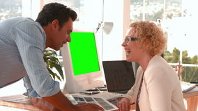 Creative business team working together at desk. In the office stock footage