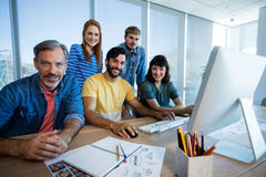 Creative business team working together on desktop pc in office Stock Images