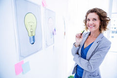 Creative business woman looking at camera Stock Photography