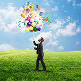 Creative businessman with colorful idea Stock Photos