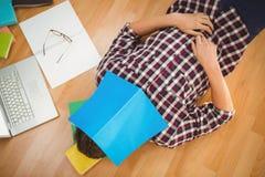 Creative businessman lying on hardwood floor Royalty Free Stock Photos
