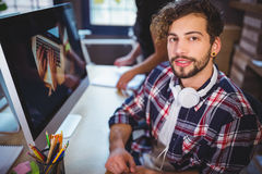 Creative businessman sitting at computer desk in office Stock Images