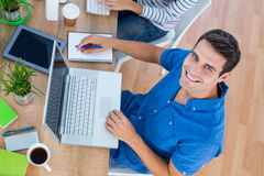 Creative businessman smiling at the camera. In a meeting stock images