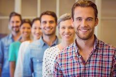 Creative businessman smiling at the camera Stock Photo