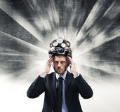 Creative businessman with steampunk helmet Stock Photography