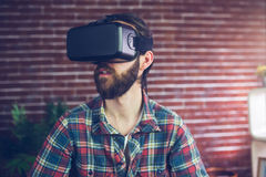 Creative businessman wearing 3D video glasses while looking away Stock Photos