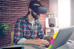 Creative businessman wearing 3D video glasses at office Stock Photo