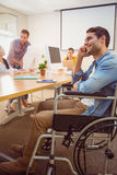 Creative businessman in wheelchair on the phone Royalty Free Stock Photos