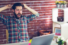 Creative businessman yawning with hands raised Royalty Free Stock Photo