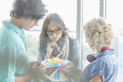 Creative businesspeople analyzing color swatches in office Royalty Free Stock Photography
