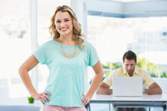 Creative businesswoman and colleagues behind Stock Photography