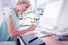 Creative businesswoman drawing plans using colour watch Royalty Free Stock Photography