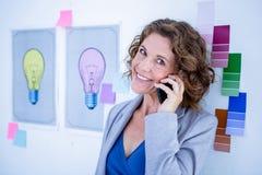Creative businesswoman having phone call Stock Image