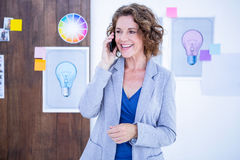 Creative businesswoman having phone call Stock Photography