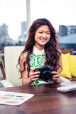 Creative businesswoman holding camera Royalty Free Stock Images