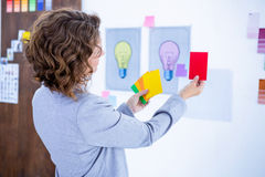 Creative businesswoman holding color cards Stock Images