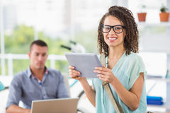 Creative businesswoman holding digital tablet Stock Image