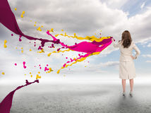 Creative businesswoman with paints splash Stock Image