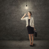 Creative businesswoman pointing lightbulb 1 Royalty Free Stock Photos