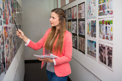Creative businesswoman pointing at photos Stock Image