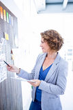 Creative businesswoman pointing pictures with pen Stock Images